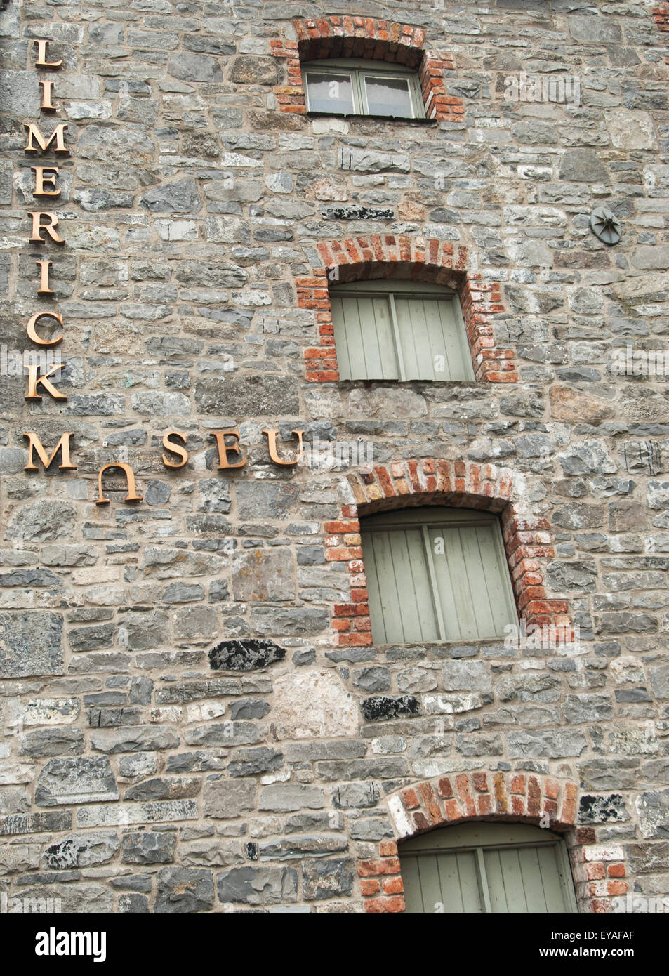 Broken Sign For Limerick Museum On The Side Of A Stone Building; Limerick, County Limerick, Ireland - Stock Image