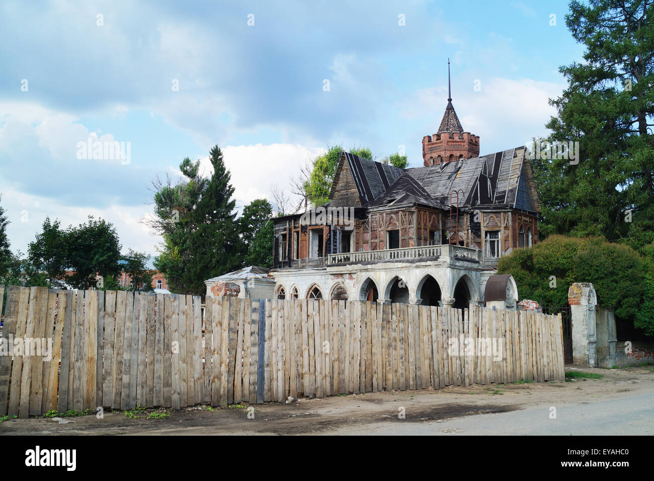 Old-time house on background blue sky - Stock Image