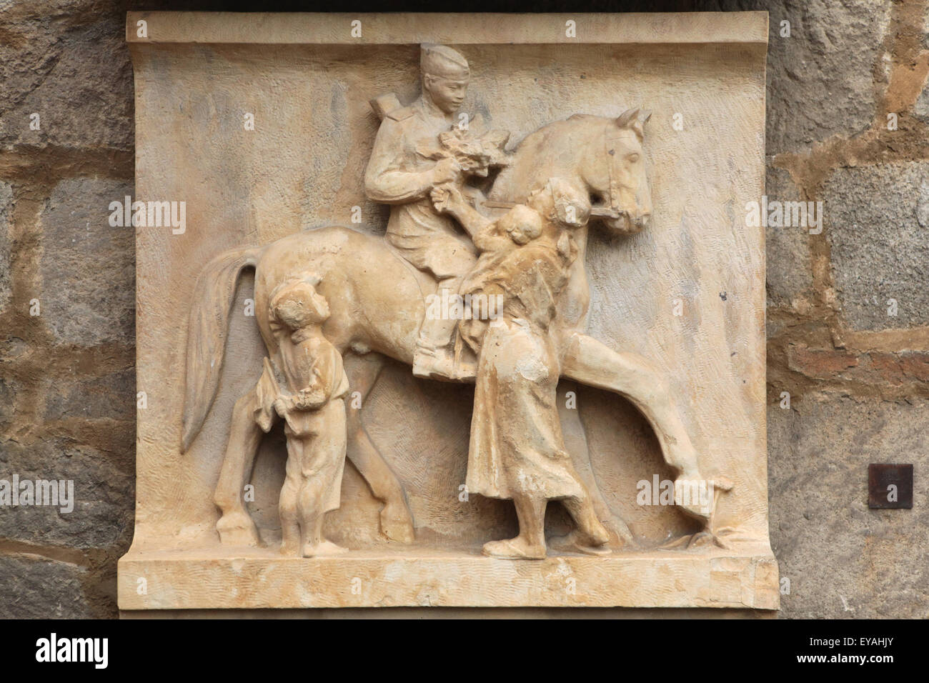 Limestone relief 'Village on May 9, 1945' (1950). by Czech sculptor Ladislav Picha displayed in the South Bohemian Stock Photo