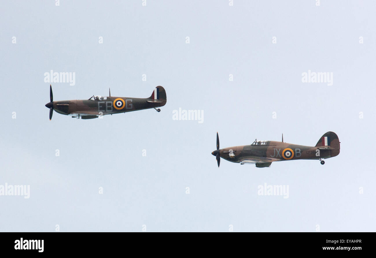 Sunderland, UK 25th July 2015. Battle of Britain Memorial Flight fighter planes Spitfire and Hurricane fly together - Stock Image