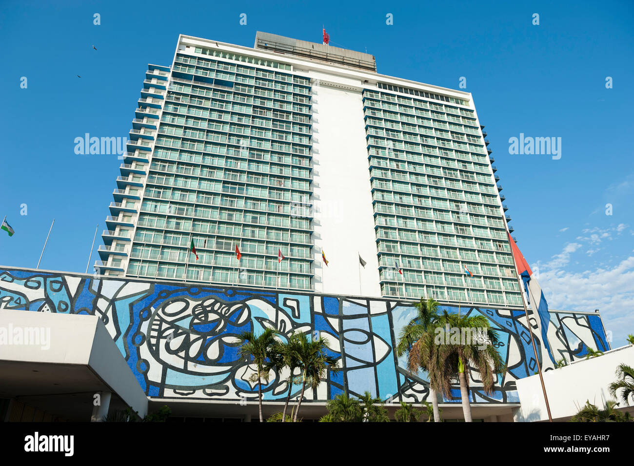 HAVANA, CUBA - JUNE, 2011: The exterior of the Hotel Tryp Habana Libre in Vedado features a large mural by artist - Stock Image