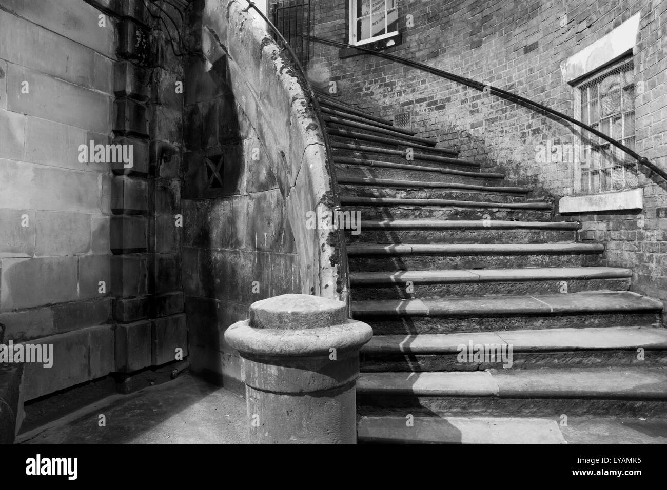 curving stone steps in a night-time urban setting - Stock Image