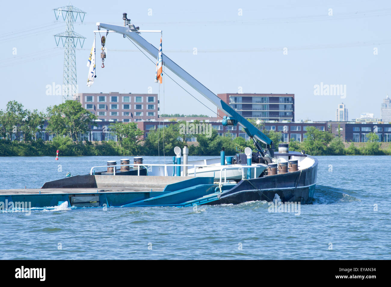 Dutch barge fully laden and low in the water. - Stock Image