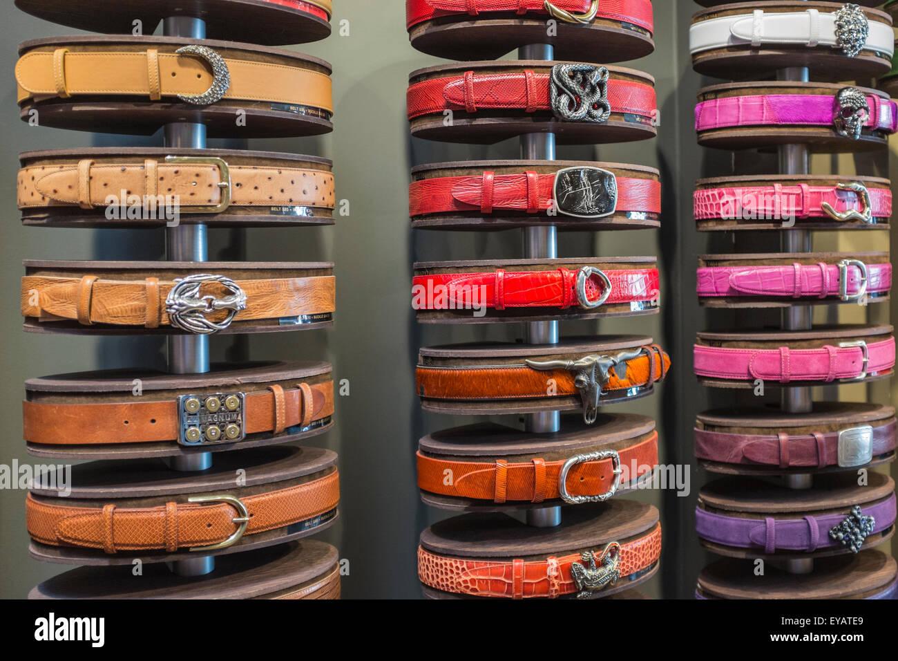 Belts lined on shelves - Stock Image