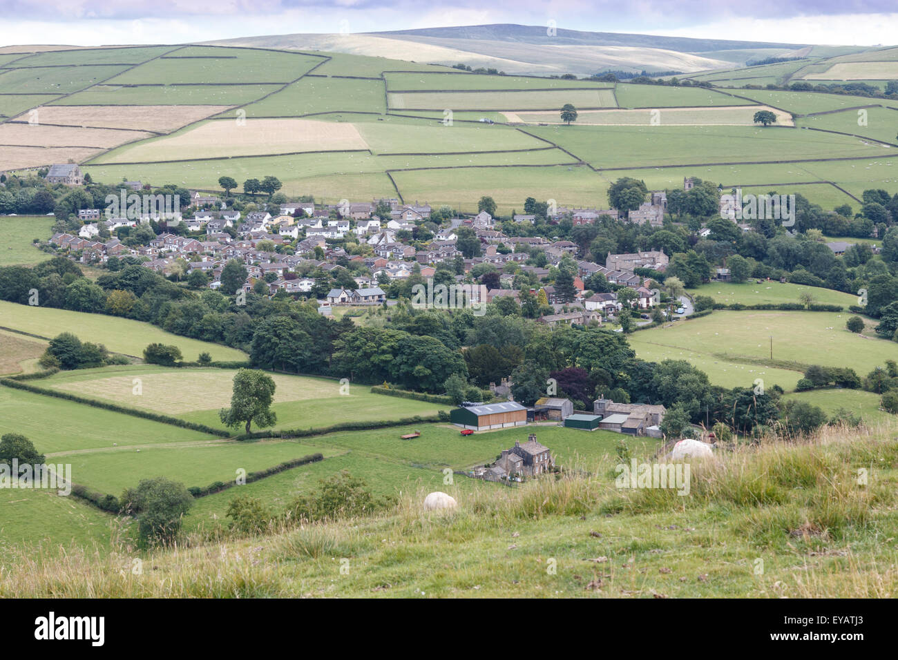 Rainow village and the Peak District moorlands above - Stock Image