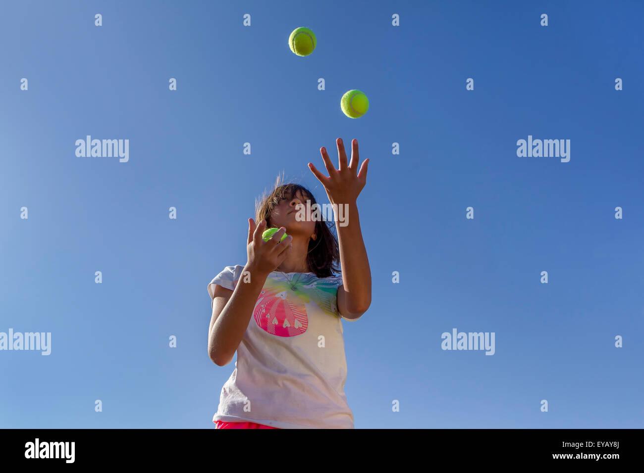 Juggling tennis balls. - Stock Image