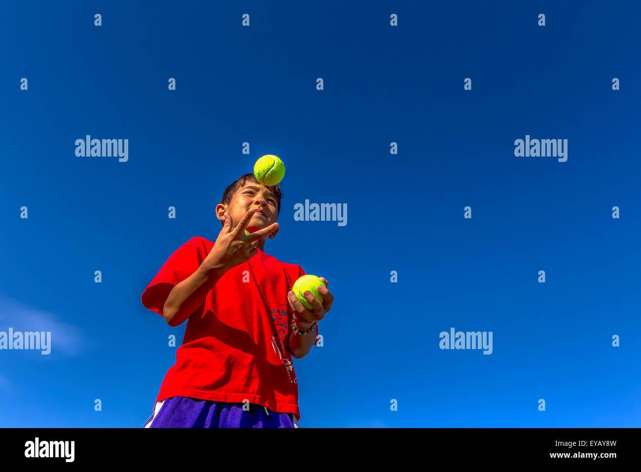 Starting to juggle. - Stock Image