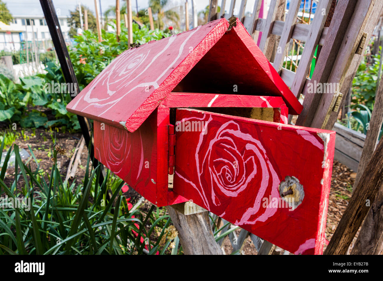 A red wooden letterbox with a white painted floral pattern on its a red wooden letterbox with a white painted floral pattern on its roof and door found in a community garden spiritdancerdesigns Image collections