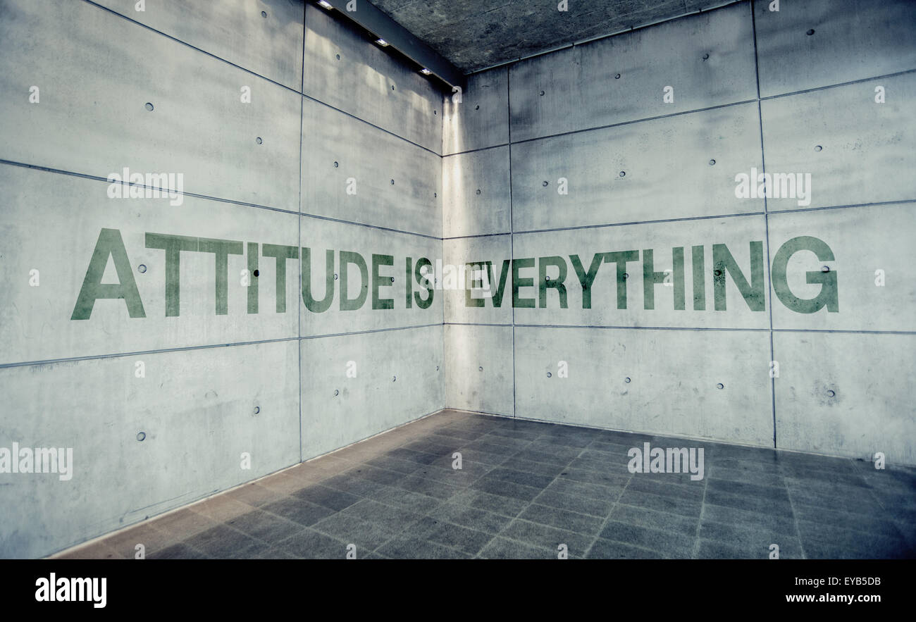 Attitude is Everything, Motivational Graffiti Message on Concrete Wall - Stock Image