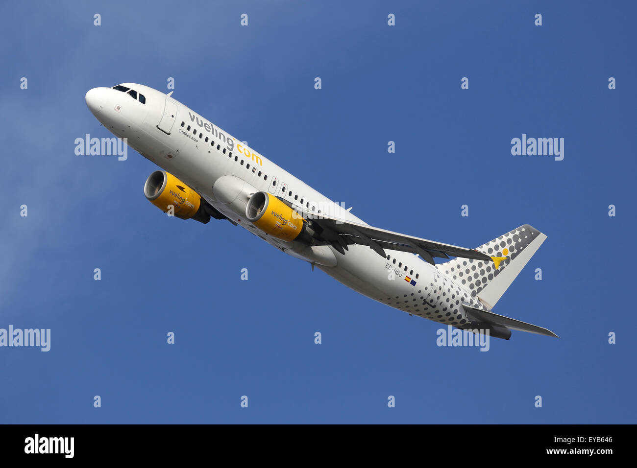 Barcelona, Spain - December 12, 2014: A Vueling Airbus A320 with the registration EC-HQJ taking off from Barcelona - Stock Image