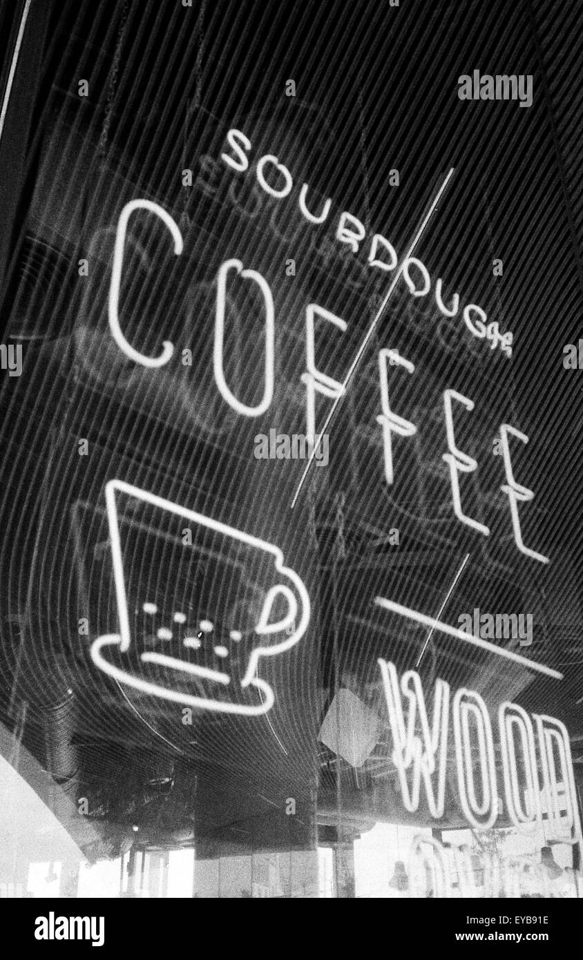 Coffee shop neon sign, shot on black and white film - Stock Image