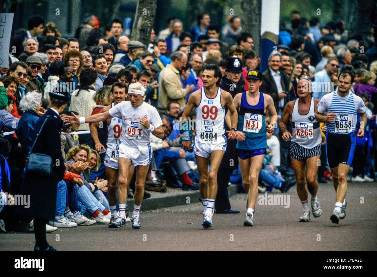 Jimmy Savile running along The Mall at the London Marathon 1989 Stock Photo
