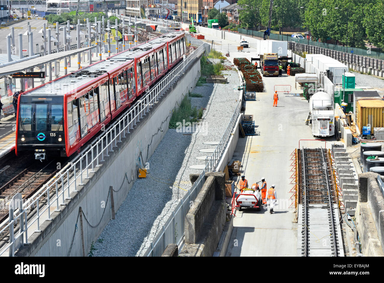 Crossrail train tracks being laid beside existing DLR train tracks on the Canary Wharf to  Abbey Wood branch line - Stock Image