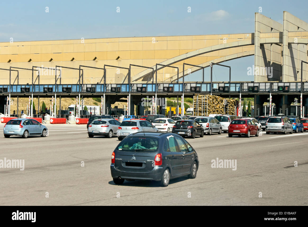 France motorway cars arriving at typical toll booths on the French Autoroute au Soleil route in Provence South of - Stock Image