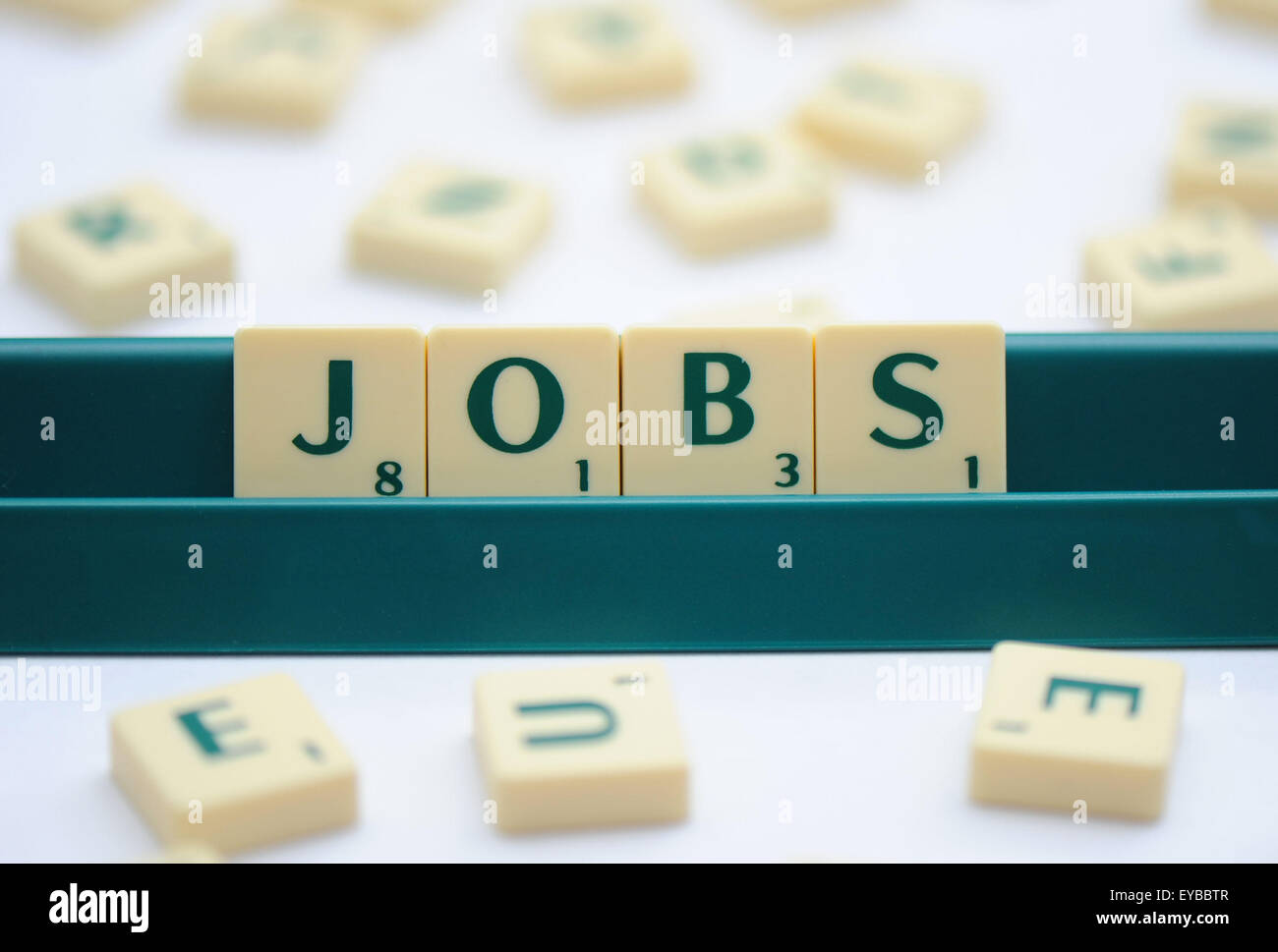 Scrabble keys spelling out the word 'jobs'. - Stock Image