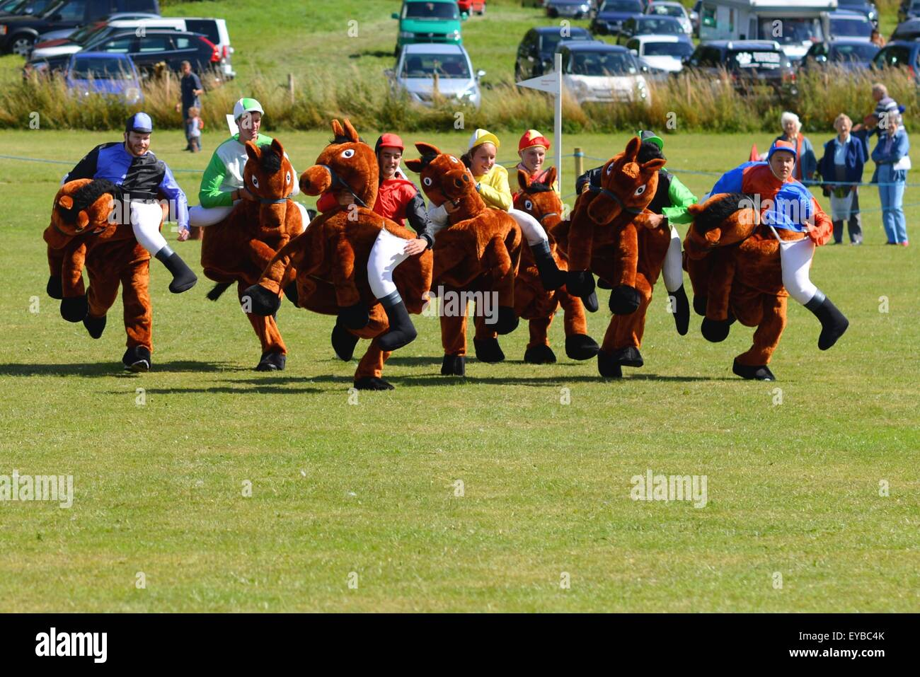 Hampshire, UK. 25th July, 2015. Runners and riders set of from the start in a Damerham Derby 'horse' race - Stock Image