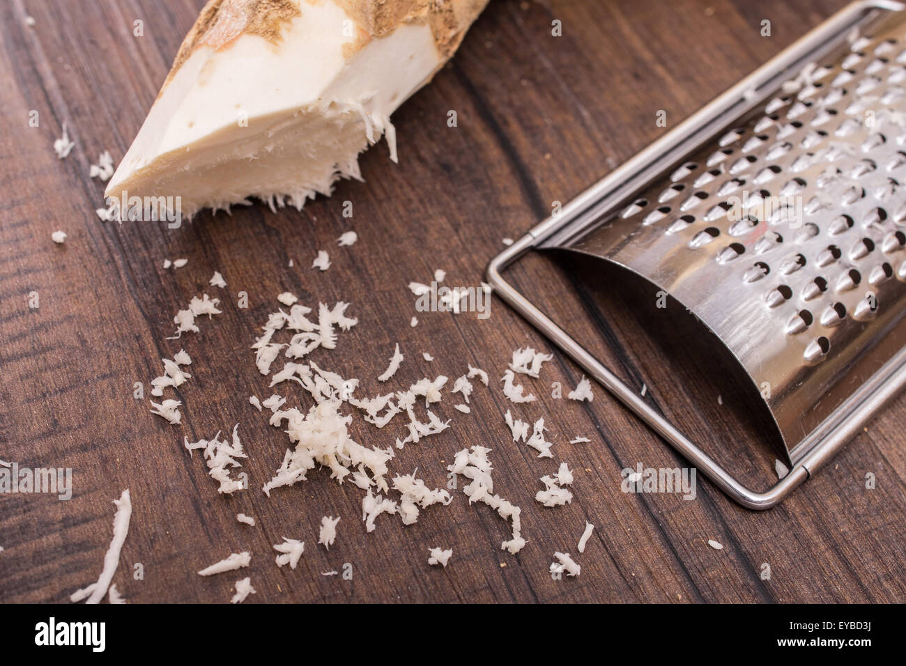 Horse radish with  kitchen utensil grater - Stock Image