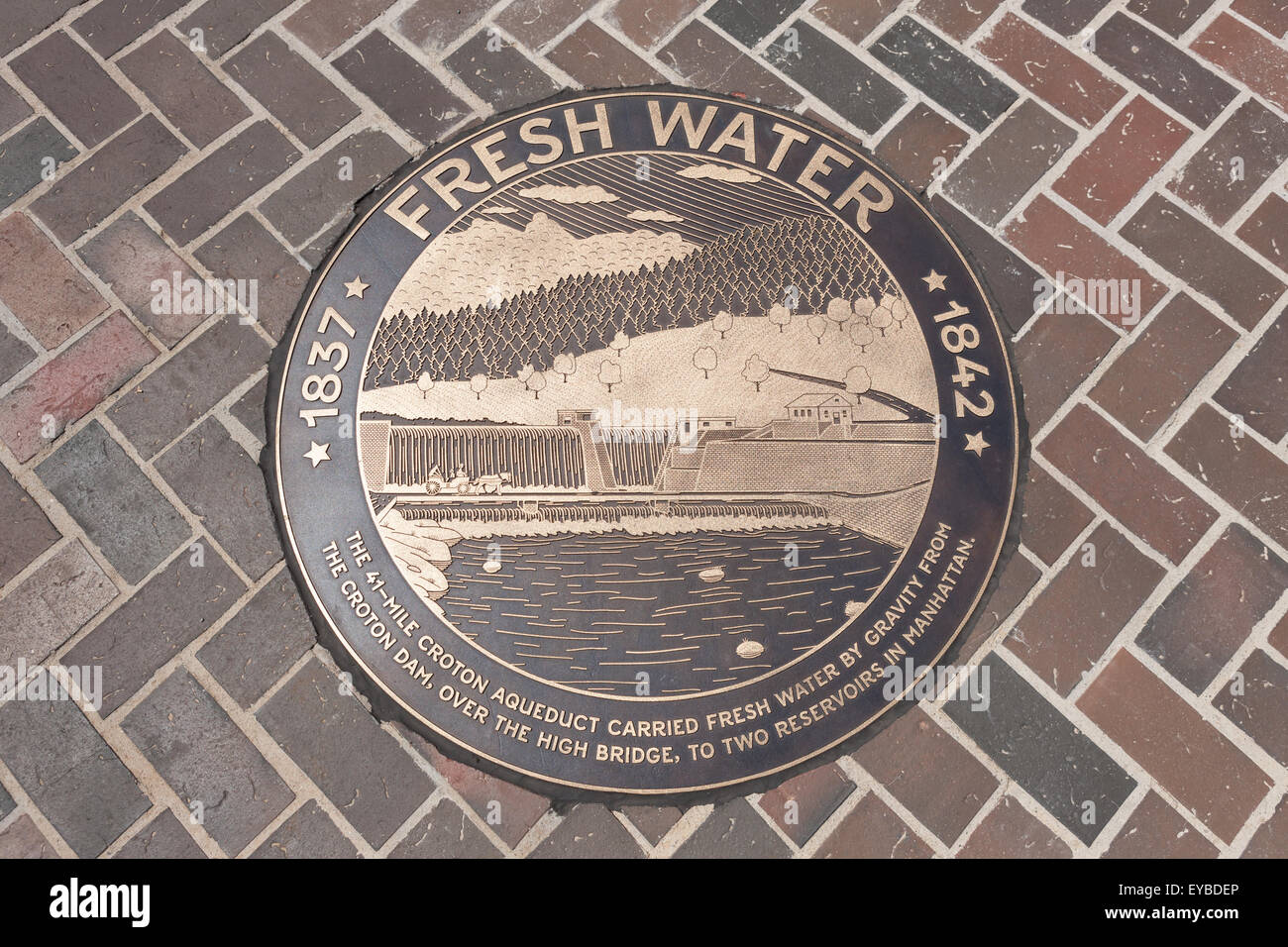 Bronze medallion in the walkway of the High Bridge connecting Manhattan with the Bronx over the Harlem River in Stock Photo