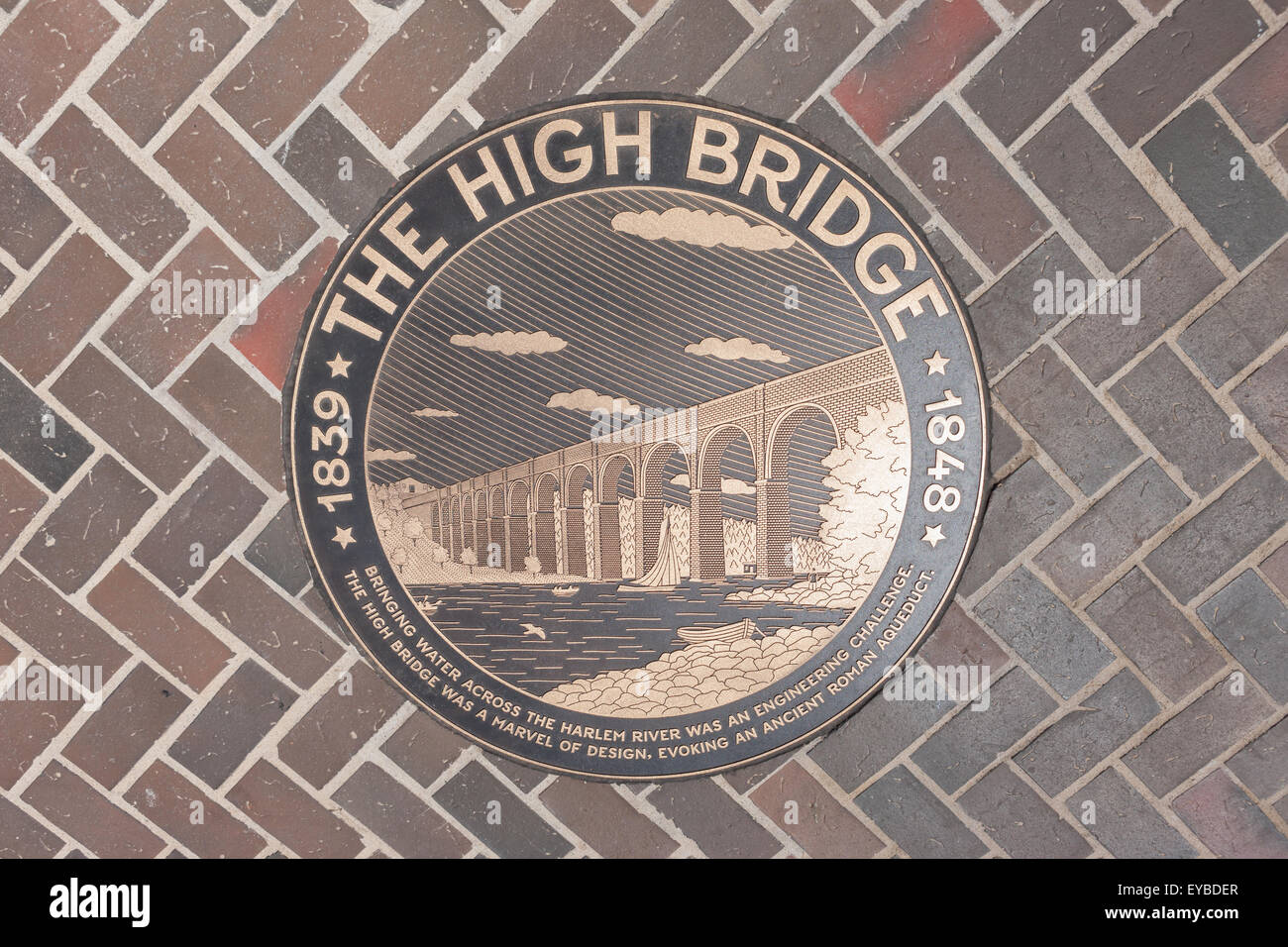 Bronze medallion in the walkway of the High Bridge connecting Manhattan with the Bronx over the Harlem River in - Stock Image