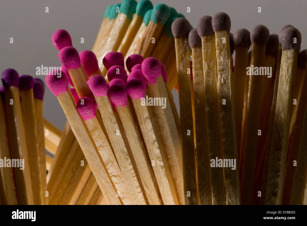 Multicoloured safety match heads. Long matches for lighting a fire. - Stock Image