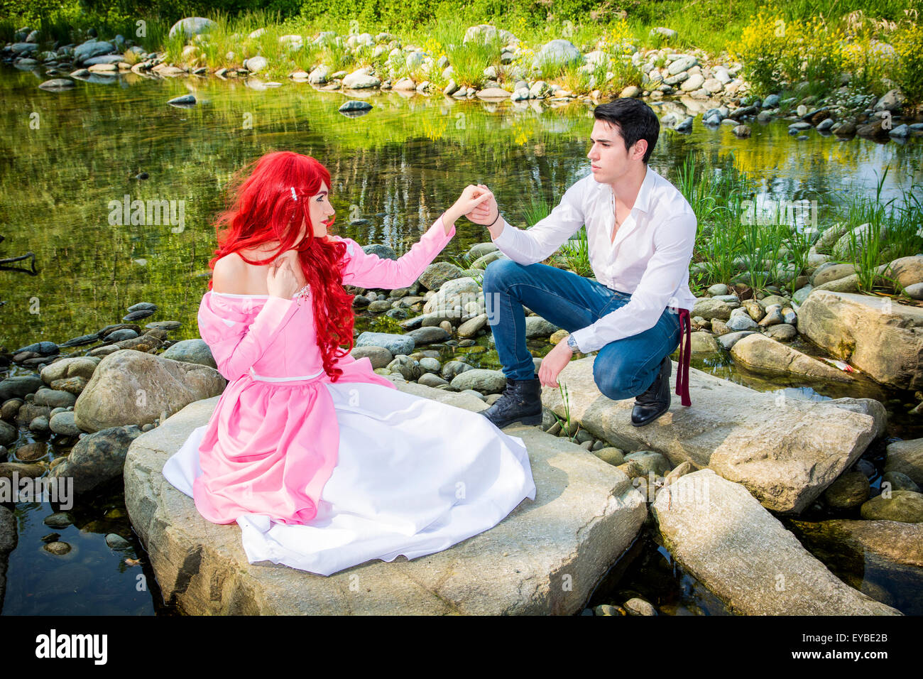 Woman In Dress Kneeling On Stock Photos & Woman In Dress ...