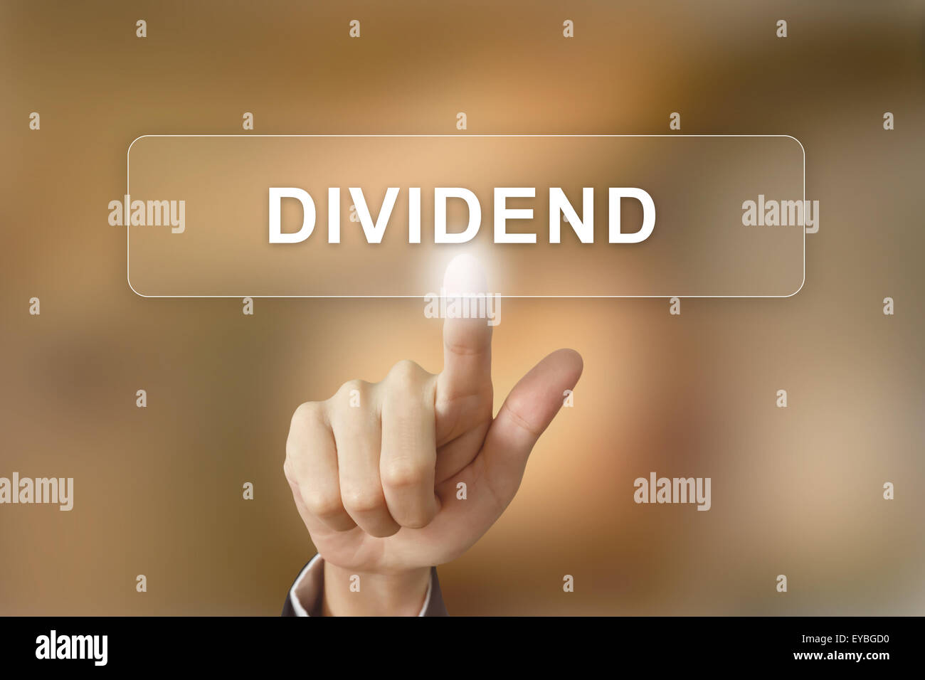 business hand pushing dividend button on blurred background - Stock Image