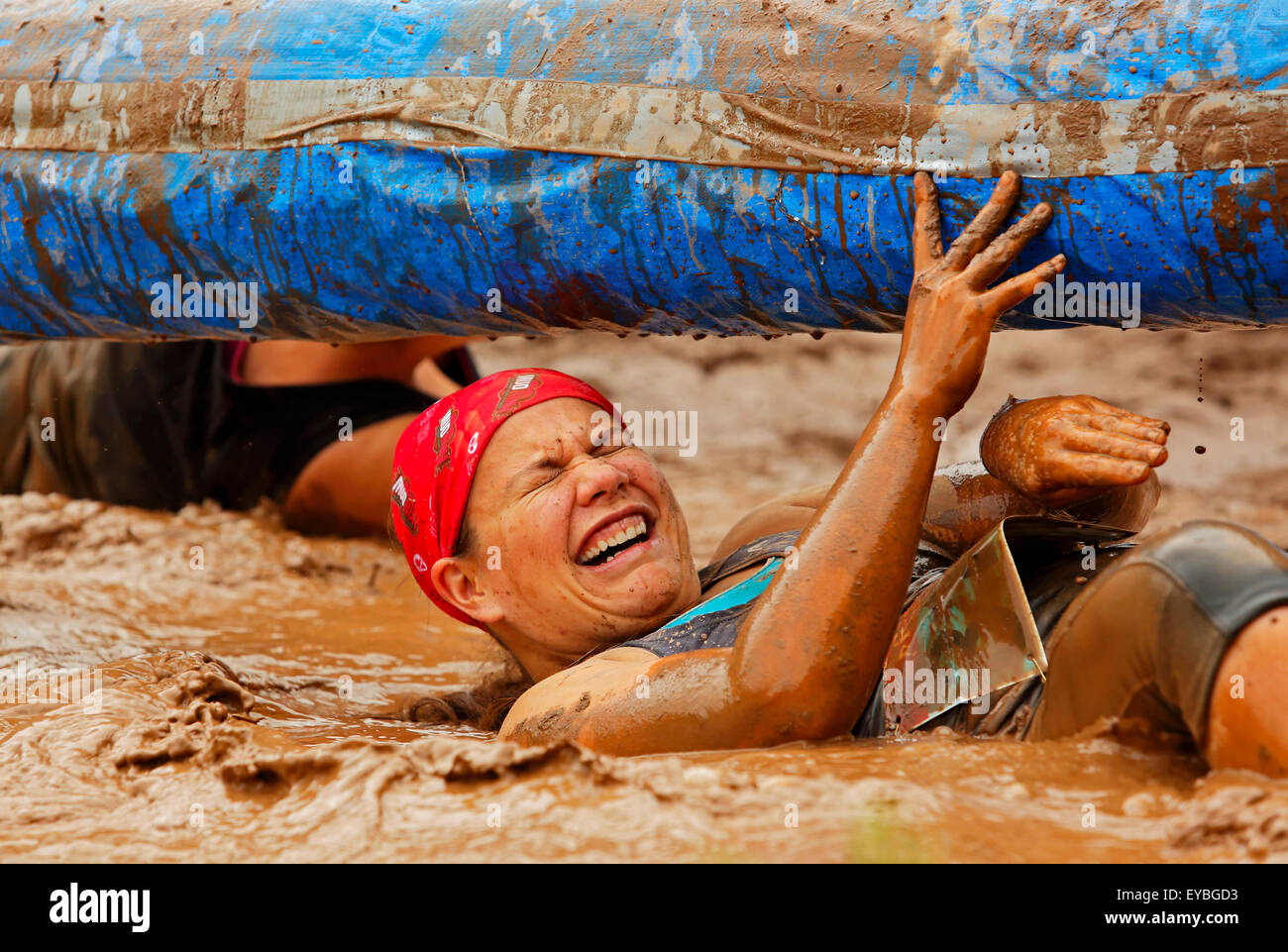 Melissa Gardner tackles a tricky area at the Mud Run for Heart July 25, 2015, Waterford, New Brunswick, Canada. - Stock Image