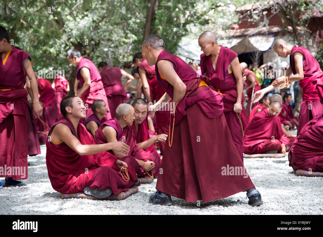 Monks debate in Lhasa, Tibet - Stock Image