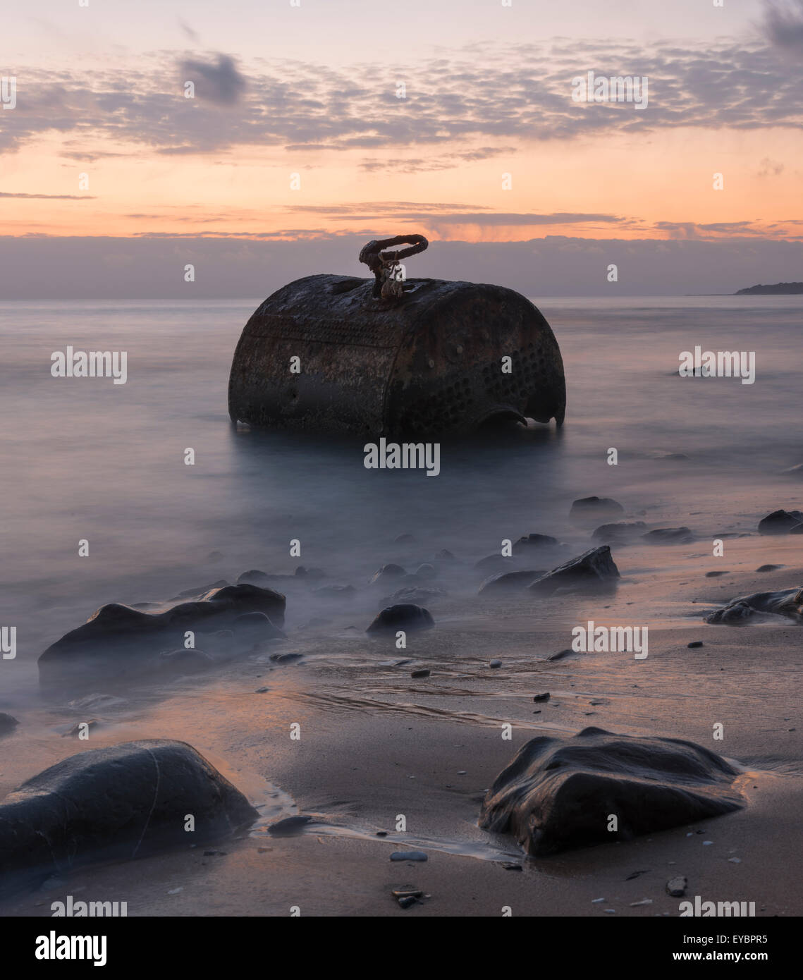Old rusty metal piece abandoned in the sea. Tarifa, Cadiz, Costa de la Luz, Andalucia, Southern Spain. - Stock Image