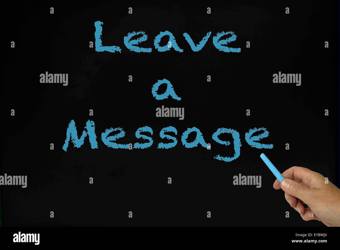 Leave a message written on chalkboard in blue with woman's hand holding the piece of chalk. - Stock Image
