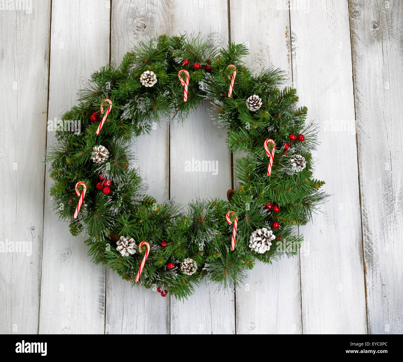 Christmas Wreath Decorated With Pine Cones Candy Canes And Red Stock Photo Alamy