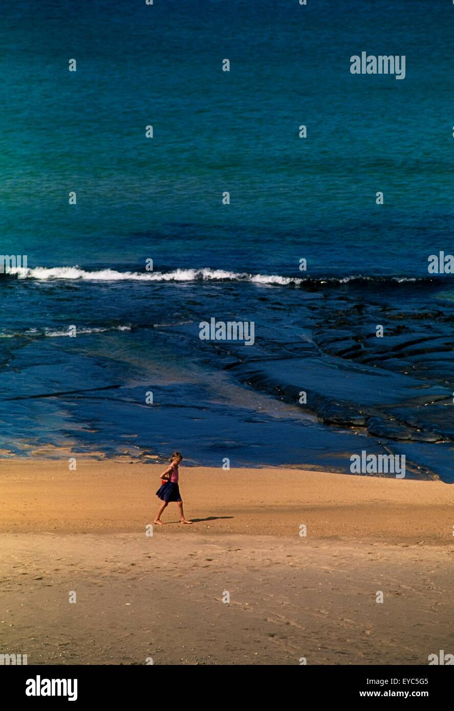Lahinch, Co Clare, Ireland; Girl On The Beach - Stock Image