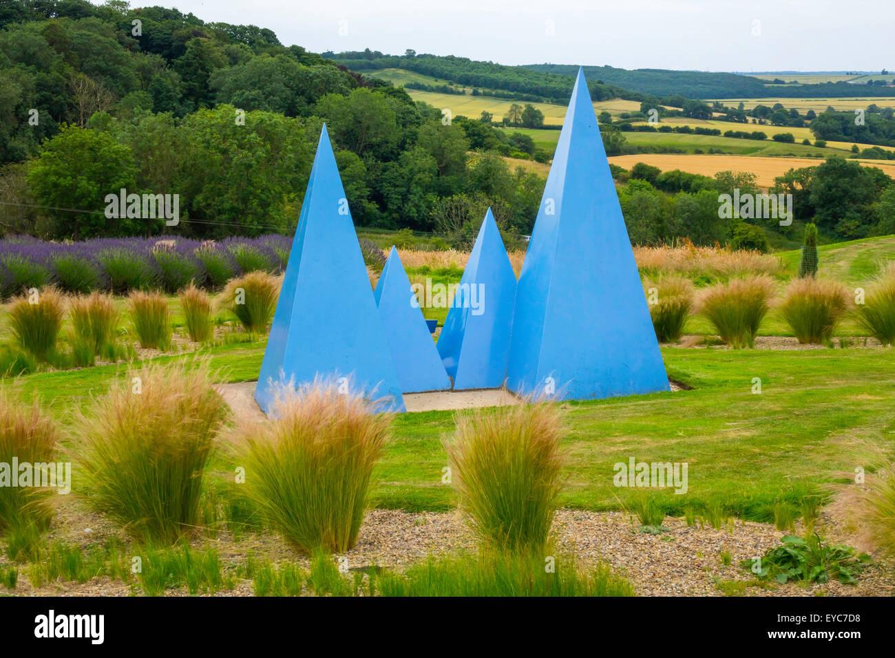 Blue pyramids mark the Memorial Garden for Lynne Goodwill co-founder at Yorkshire Lavender Terrington York UK - Stock Image