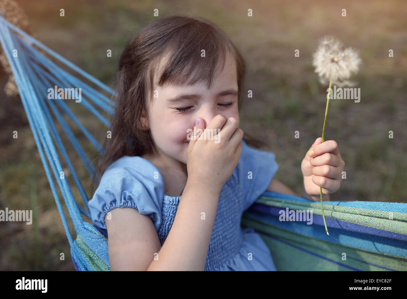 Fever runny nose - little girl with dandelions - Stock Image