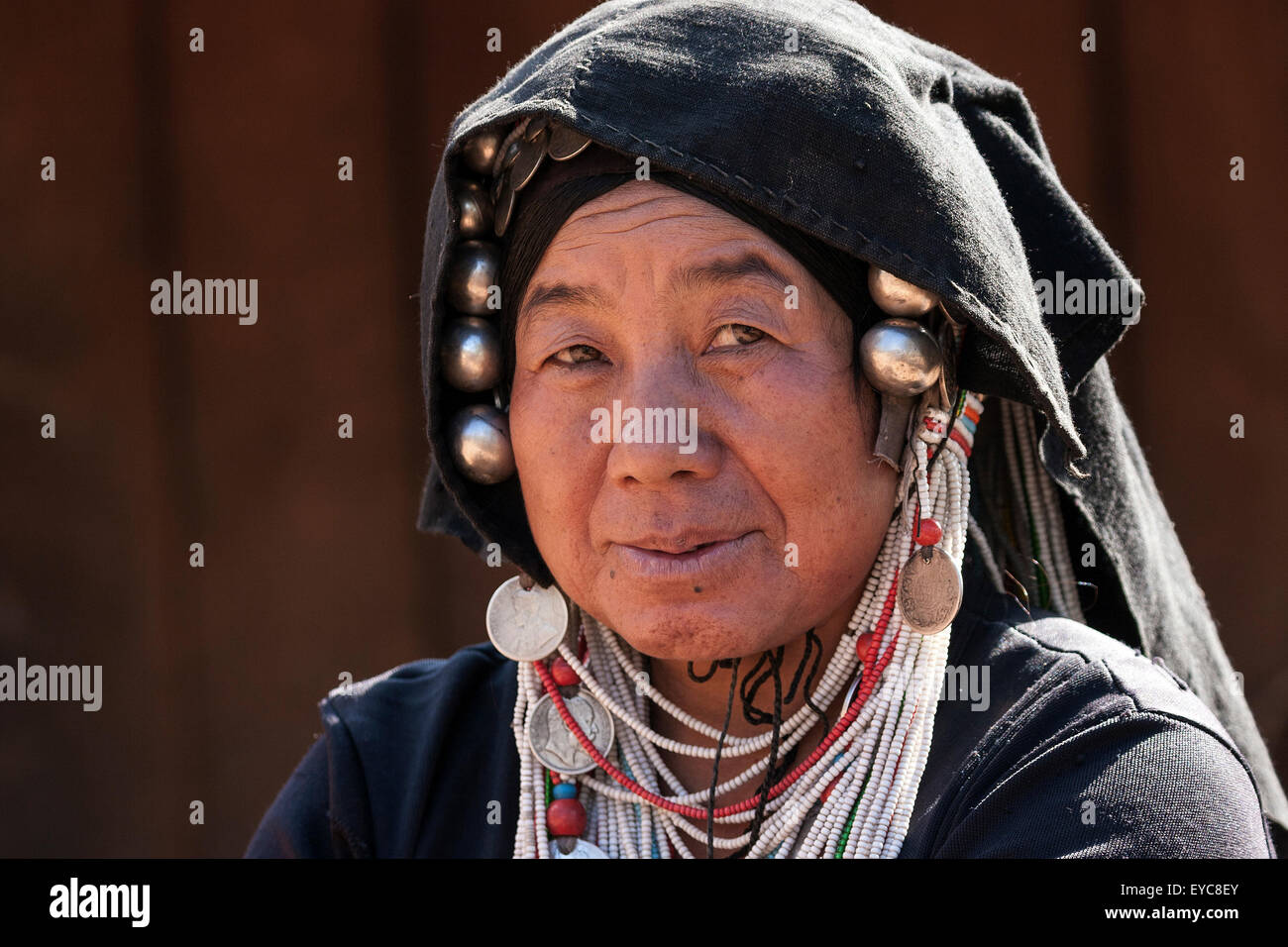 Local woman from the Akha tribe with typical headdress, portrait, Hokyin Akha Village, near Kyaing Tong, Shan State - Stock Image