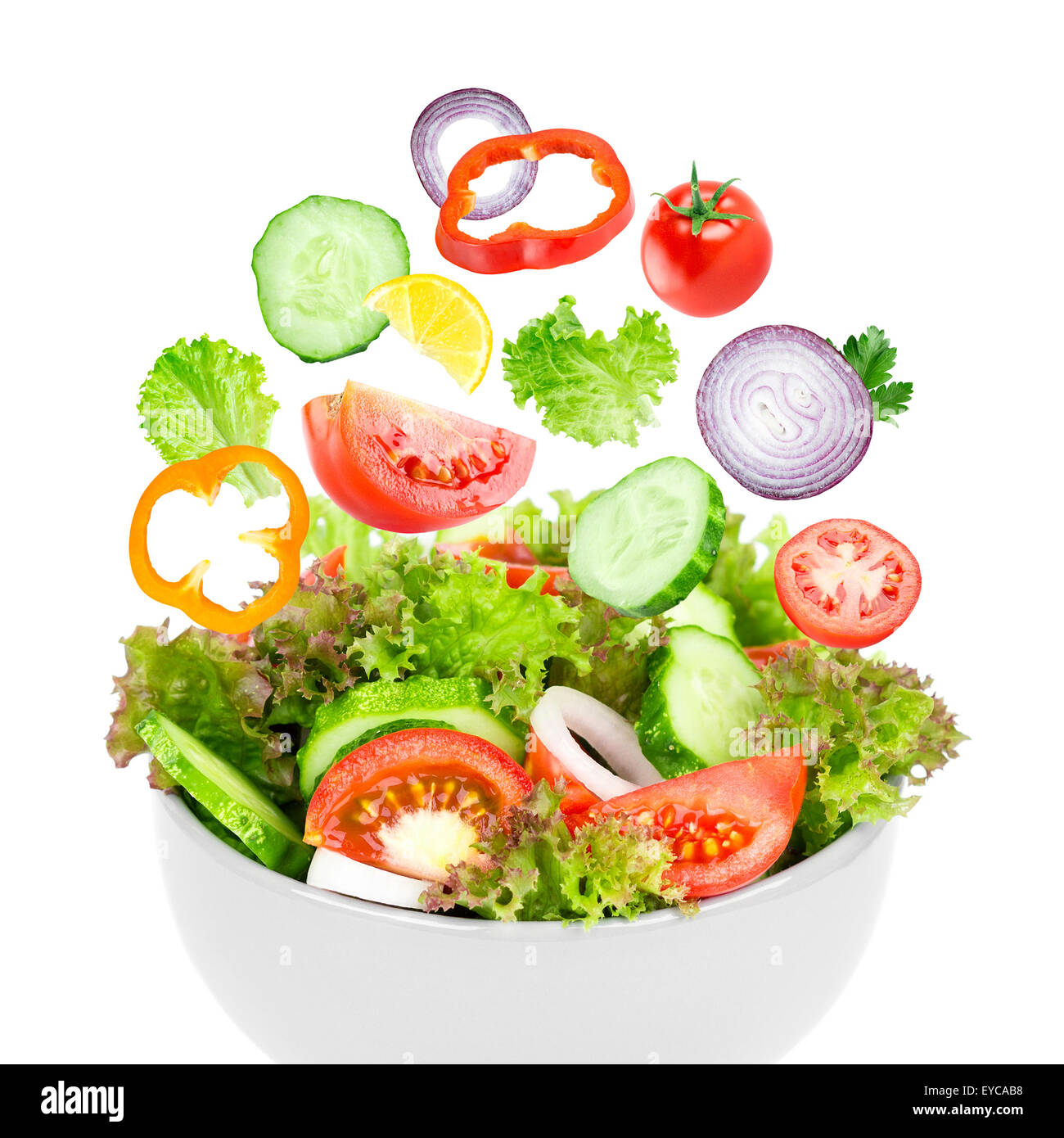 Fresh Salad Mixed Falling Vegetables In Bowl On White