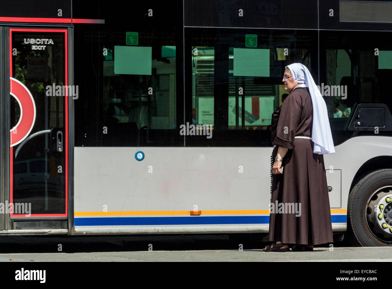 Nun waiting to catch a bus. - Stock Image