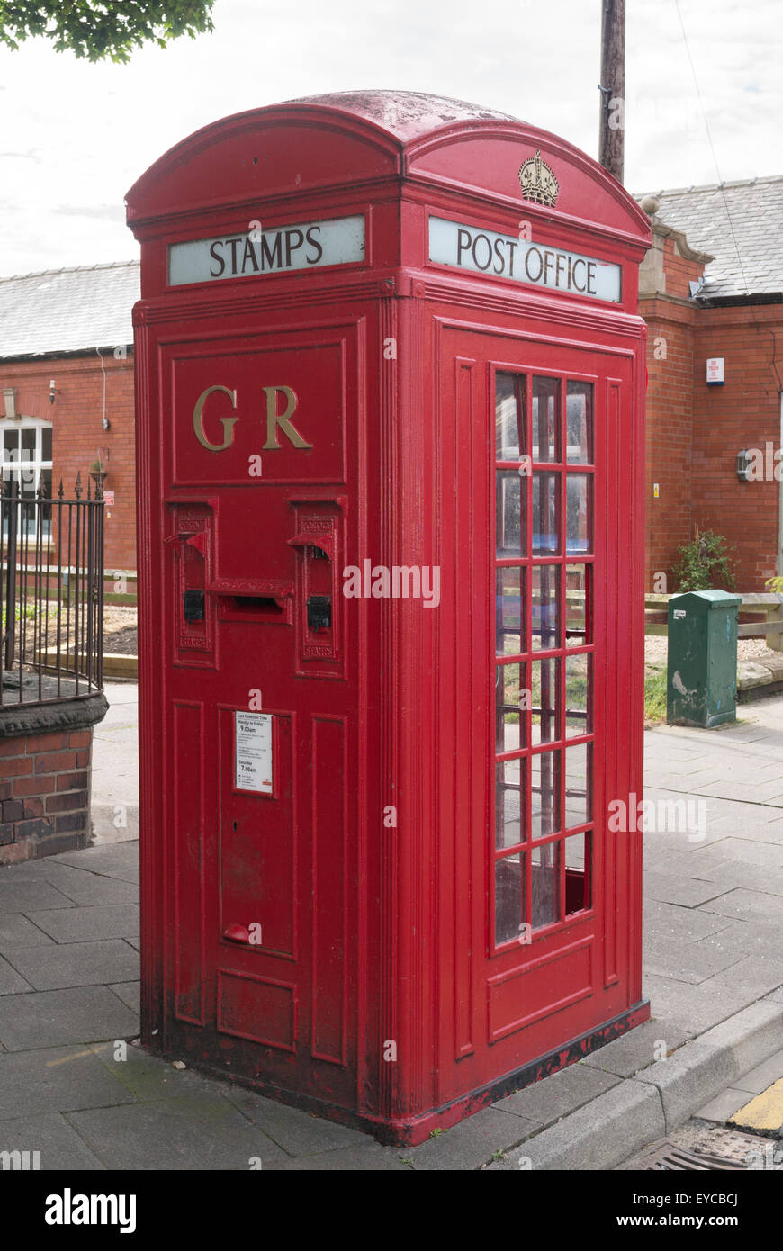 Unusual 1930s combined telephone kiosk and post box with stamp machines, Post Office K4 design, Whitley Bay, North - Stock Image