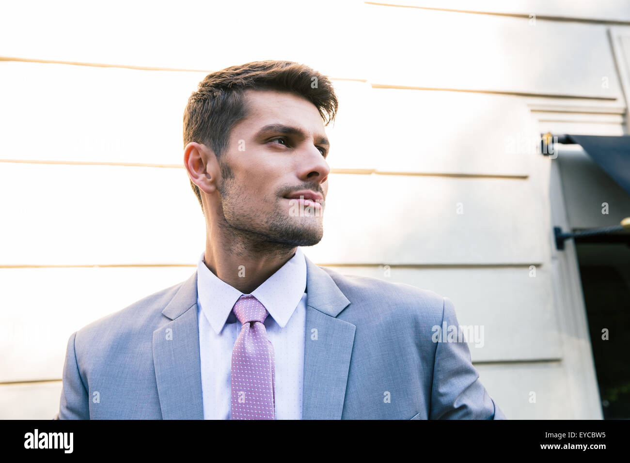 Portrait of a handsome businessman standing outdoors and looking away Stock Photo