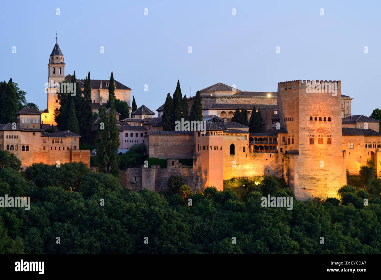 View of Alhambra Palace complex at dusk in Granada, Andalusia, Spain - Stock Image