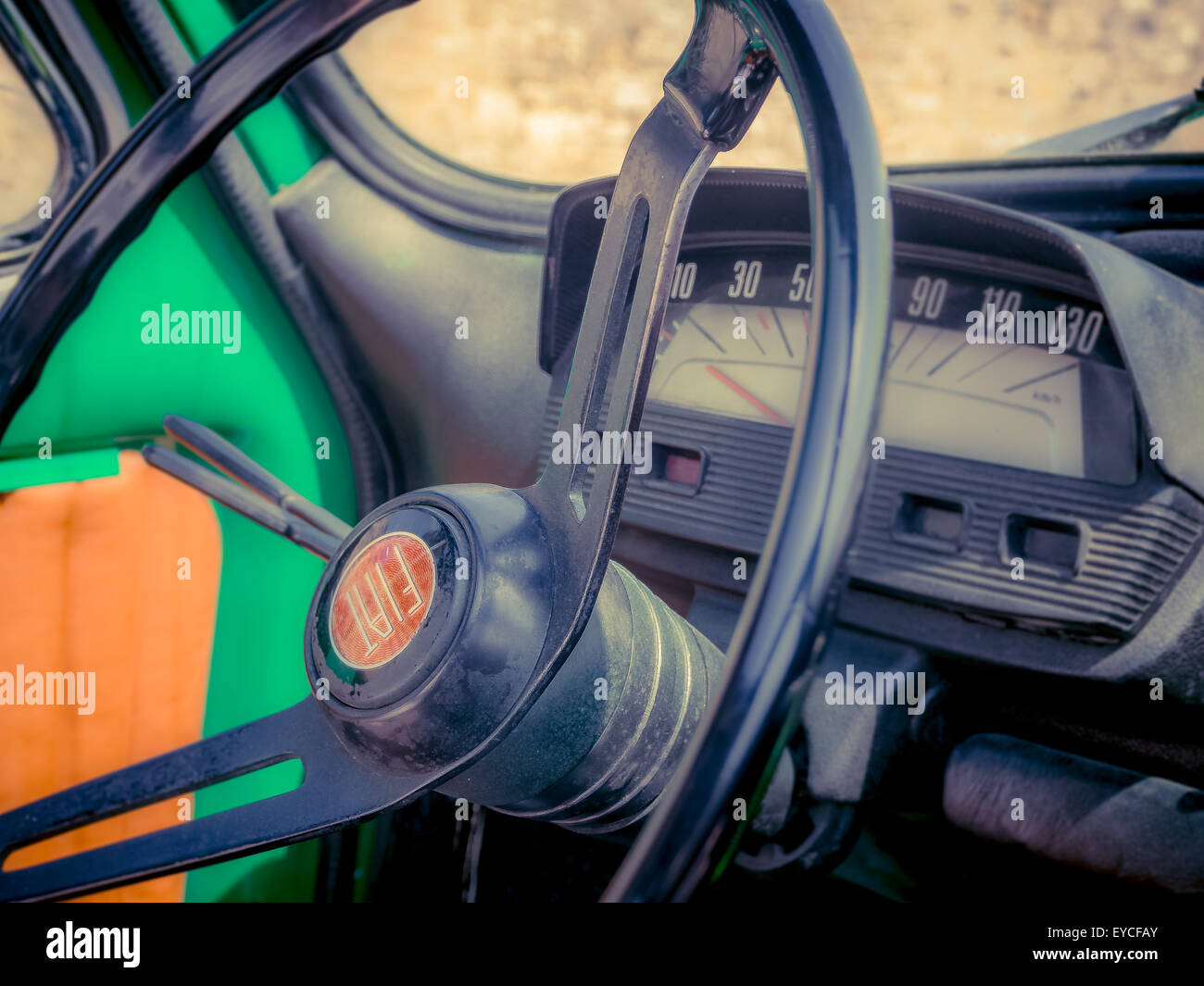 Close-up of a steering wheel on a classic Fiat 500 car. - Stock Image