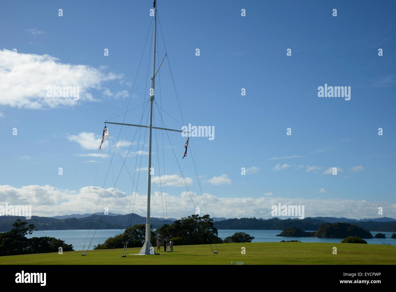 Treaty of Waitangi signed in the Bay of Islands in New Zealand. The flagstaff marks the spot where the Treaty of - Stock Image