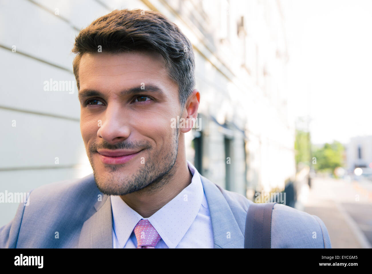 Portrait of a happy businessman outdoors looking away Stock Photo