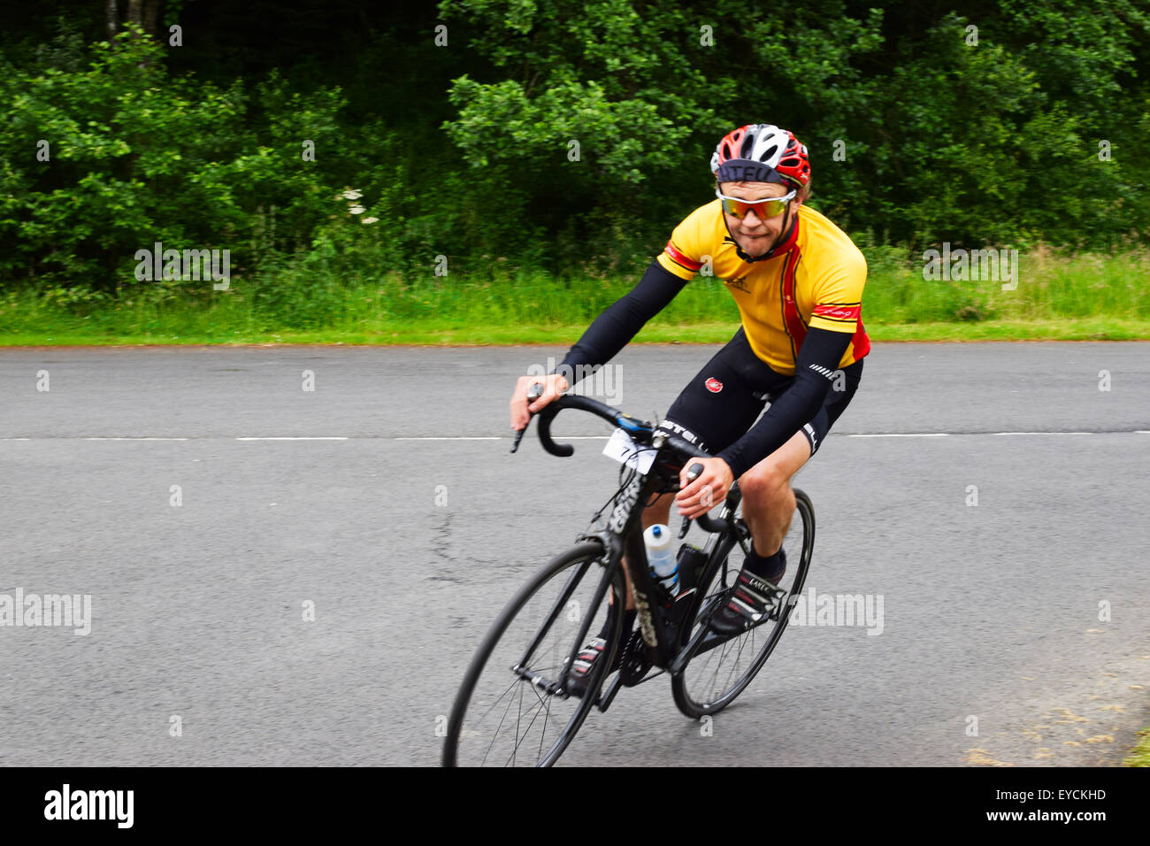 Riders passing through Kielder on the Wooler Wheel Big Un cycle sportive in July 2015. - Stock Image
