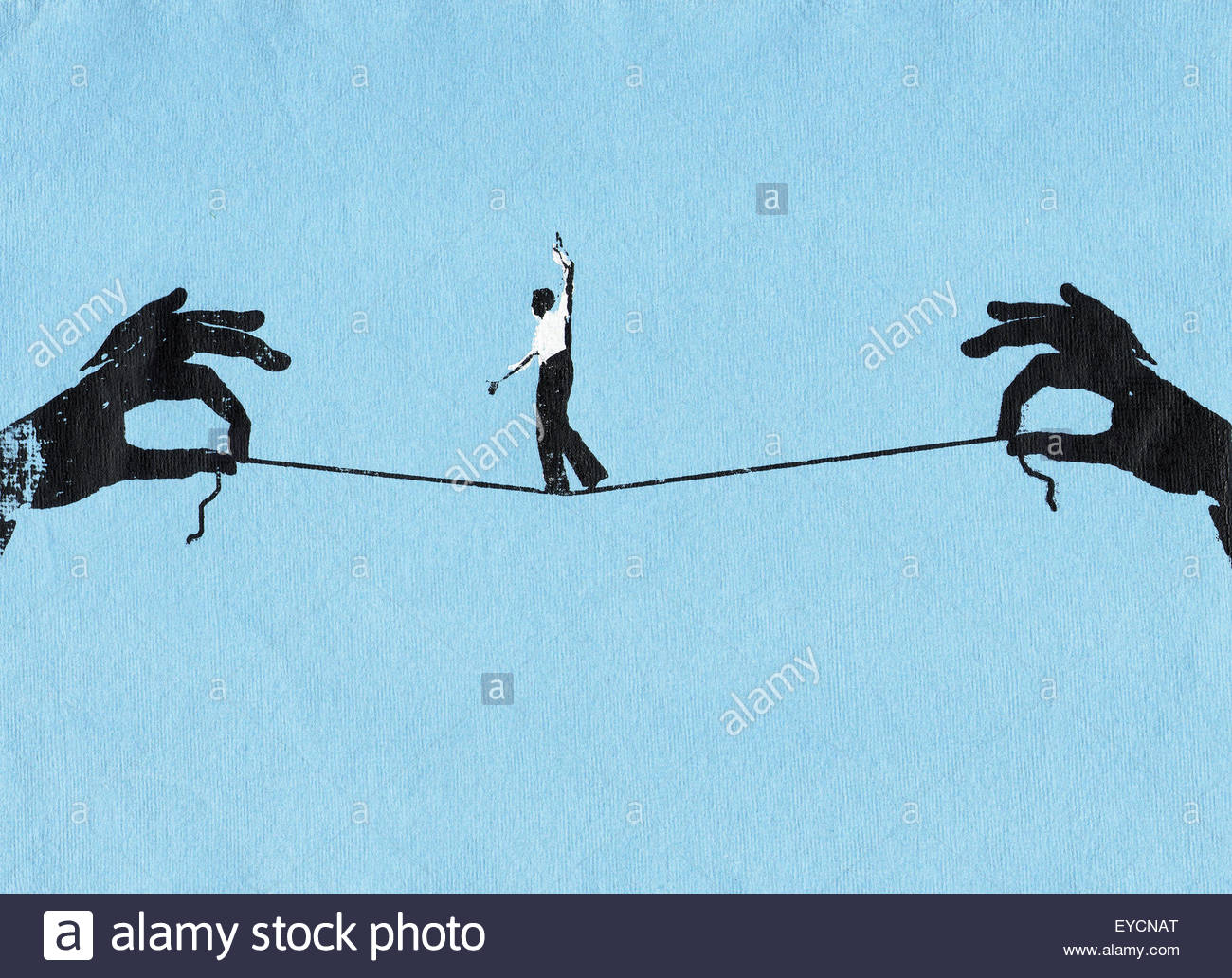 Businessman walking tightrope on string between two hands - Stock Image