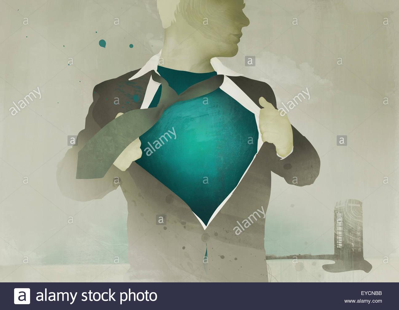 Businessman revealing superhero costume under suit - Stock Image