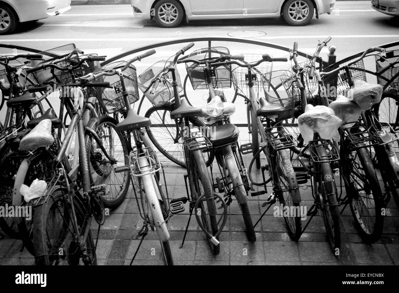 Bicycles parked in Shanghai - Stock Image