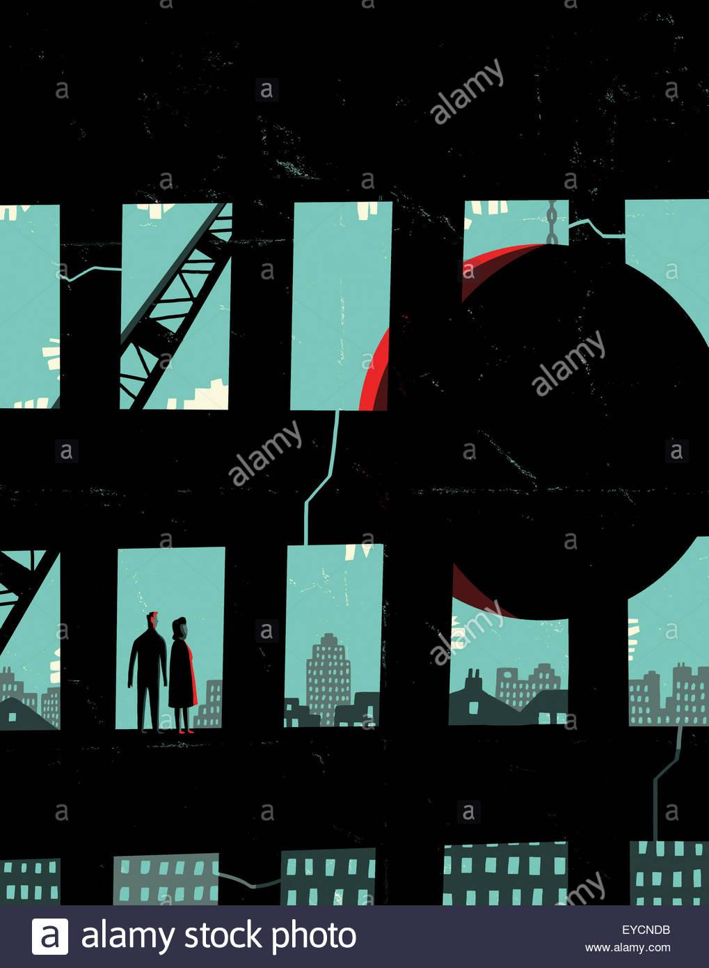 Couple watching wrecking ball demolishing highrise building - Stock Image