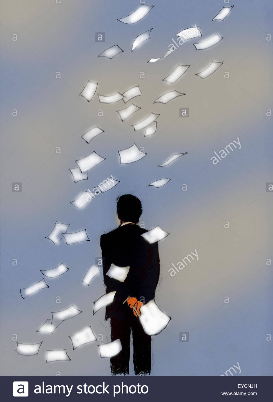 Businessman watching papers blowing away - Stock Image
