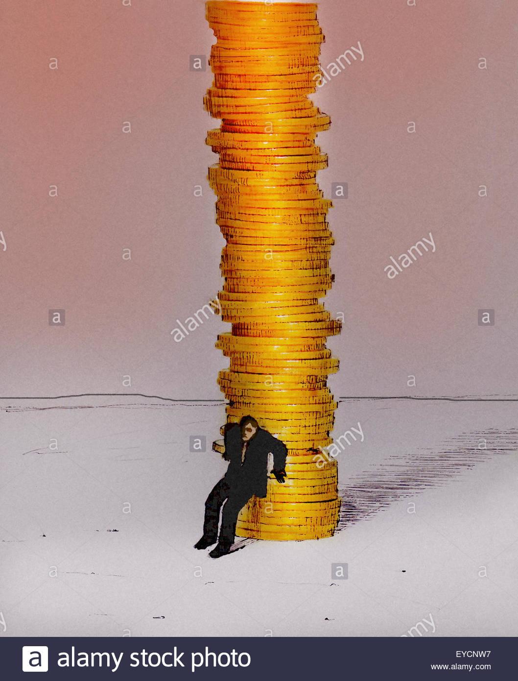 Businessman protecting large pile of money - Stock Image